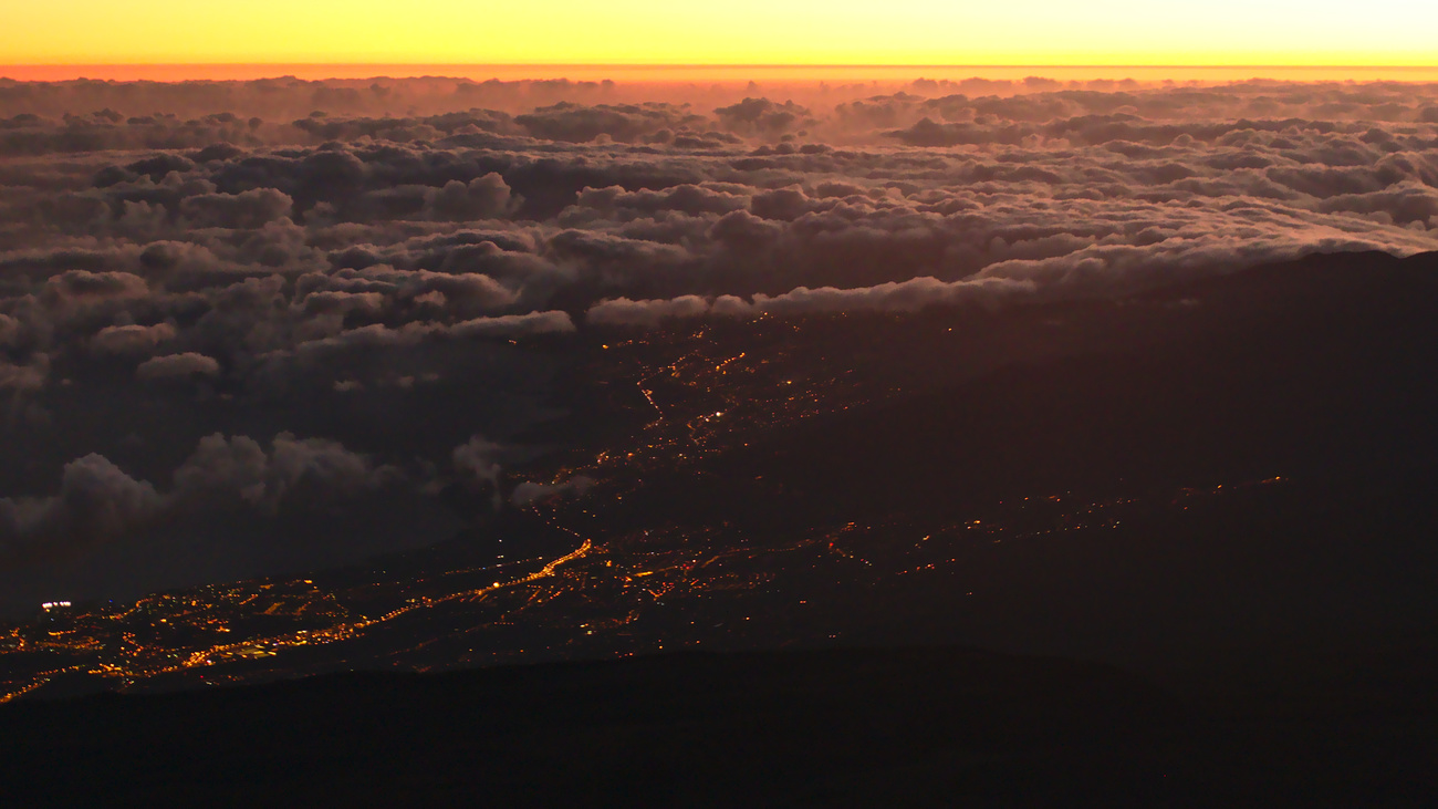 City lights at sunrise, viewed from Mount Teide, 3718 MAMSL, Tenerife.